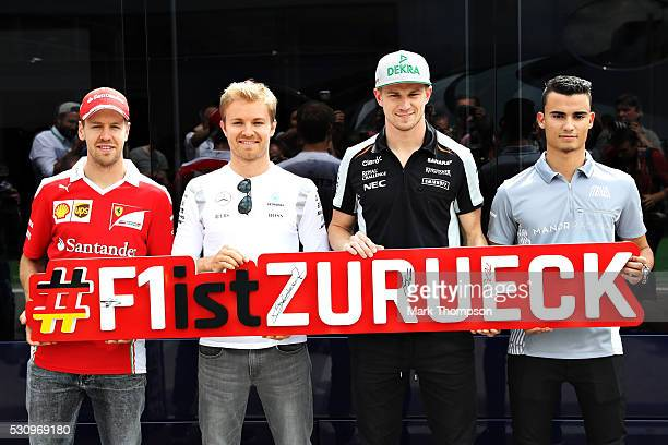 The four German drivers on the grid Sebastian Vettel of Germany and Ferrari Nico Rosberg of Germany and Mercedes GP Nico Hulkenberg of Germany and...