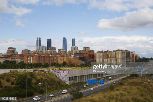 The four towers of the Cuatro Torres Business Area stand beyond residential housing blocks in Madrid on Wednesday June 28 2017 Bankia SA agreed to...