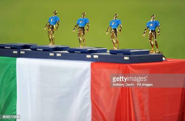 The four trophys presented to Italy's Gianluigi Buffon Paulo Maldini Dino Zoff and Fabio Cannavaro for earning 100 or more international caps
