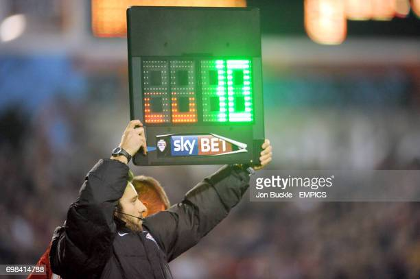 The fourth official holding up the electronic board to signify a substitution