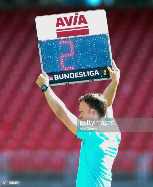 The fourth official holds the Avia board during the Second Bundesliga match between 1 FC Nuernberg and 1 FC Kaiserslautern at MaxMorlockStadion on...