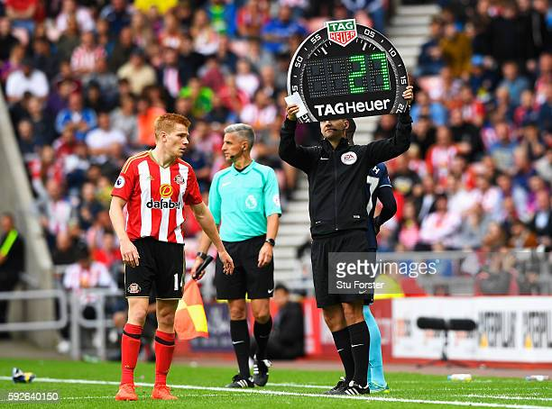 The fourth official holds the electronic board with a substitution during the Premier League match between Sunderland and Middlesbrough at Stadium of...