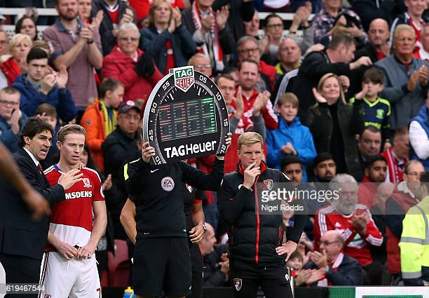 The fourth official holds up the substitutes board during the Premier League match between Middlesbrough and AFC Bournemouth at Riverside Stadium on...