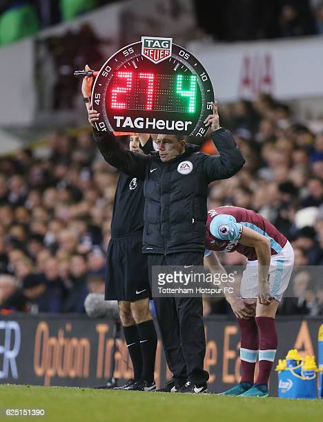 The fourth official holds up the substitution board during the Premier League match between Tottenham Hotspur and West Ham United at White Hart Lane...