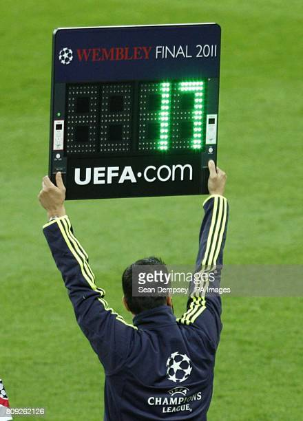 The fourth official holds up the substitution board