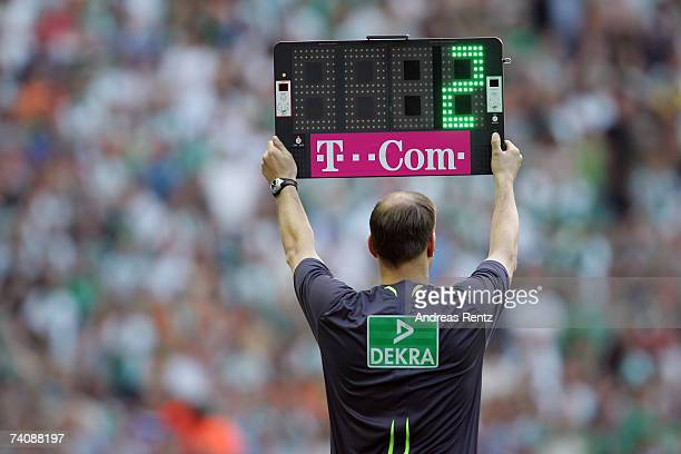 The fourth referee holds a board that shows two minutes extra time during the Bundesliga match between Hertha BSC Berlin and Werder Bremen at the...
