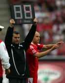 The fourth referee holds the display for substitution during the Bundesliga match between 1FC Koeln and Eintracht Frankfurt at the RheinEnergyStadium...