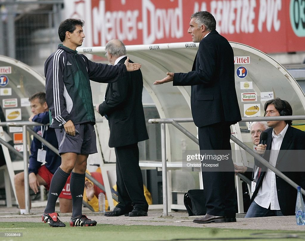 The fourth referee sends head coach Mirko Slomka off the sideline and into the dug out during the UEFA Cup second leg match between AS Nancy and...