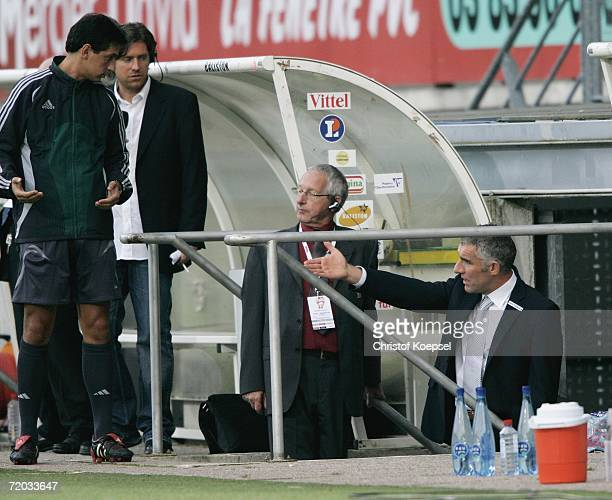 The fourth referee sends head coach Mirko Slomka off the sideline into the dog out during the UEFA Cup second leg match between AS Nancy and Schalke...