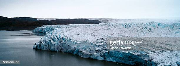 The fracture zone of a glacier on the Greenland Ice Sheet ending in a lake.