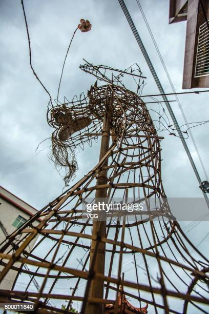 The frame of a dragon is seen on June 19 2017 in Meizhou Guangdong Province of China The fire dragon dance of Puzhai Town at Fengshun County is a...