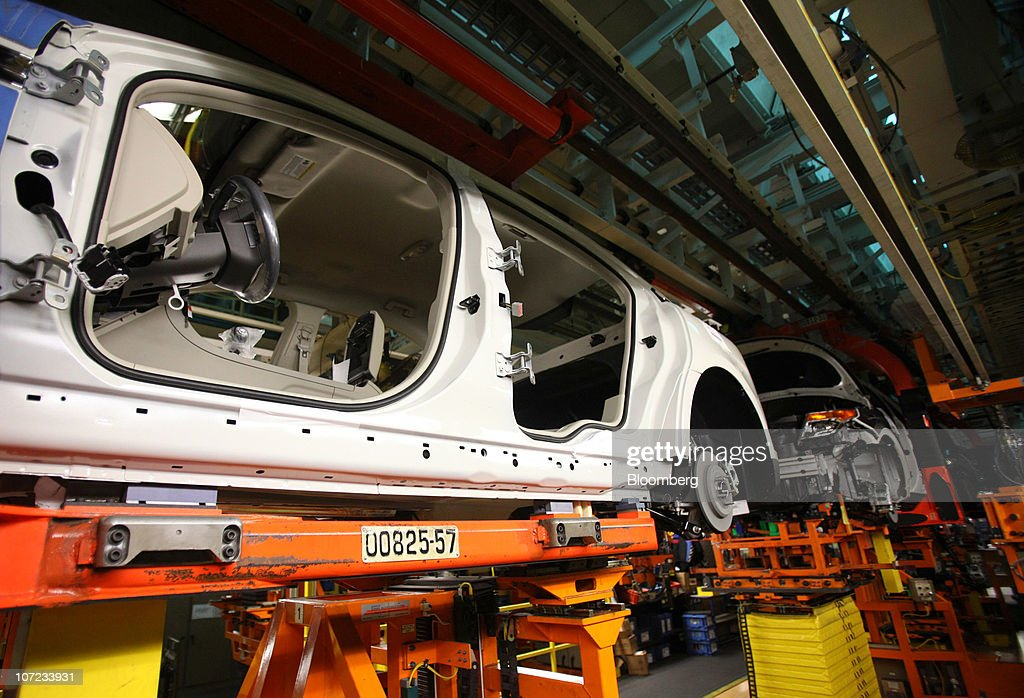 The Frame Of A New Ford Motor Co Taurus Moves Along The
