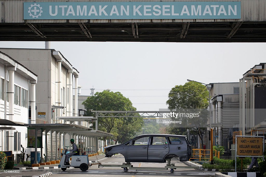 The frame of Toyota Motor Corp. Kijang Innova is transported at PT. Toyota Motor Manufacturing Indonesia's (TMMIN) Karawang plant, in Karawang, West Java, Indonesia on Wednesday, Sept. 14, 2011. Toyota Motor Corp., the biggest carmaker in Asia, plans to build a second factory in Indonesia at a cost of 26.3 billion yen ($341 million) to help boost sales in emerging markets. Photographer: Dimas Ardian/Bloomberg via Getty Images