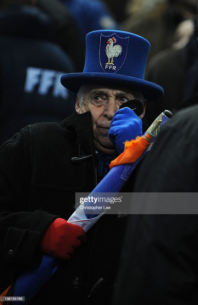 The France mascot wraps up from the cold as the match is cancelled during the RBS 6 Nations match between France and Ireland at Stade de France on February 11, 2012 in Paris, France.