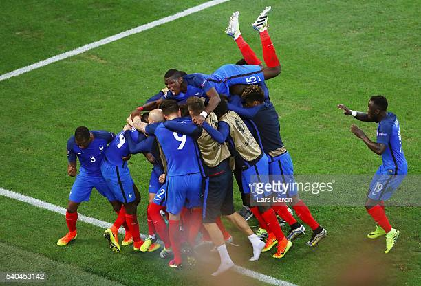 the France squad celebrate with Antoine Griezmann after he scored his sides first goal during the UEFA EURO 2016 Group A match between France and...
