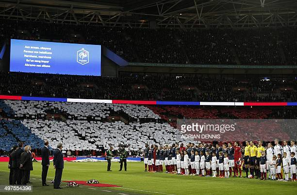 The France team are pictured as they sing their national anthem before the start of the friendly football match between England and France at Wembley...