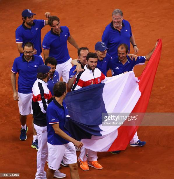 The France team celebrate victory after the doubles match between Dominic Inglot and Jamie Murray of Great Britain and Julien Benneteau and Nicolas...