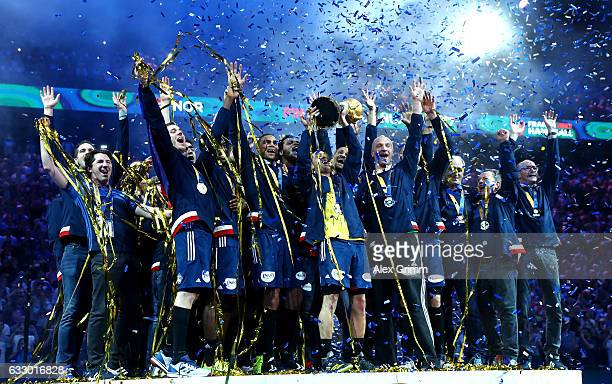 The France team celebrate victory with the trophy after the 25th IHF Men's World Championship 2017 Final between France and Norway at Accorhotels...