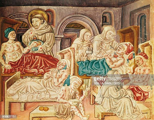 The Franciscans treating victims of the plague miniature from La Franceschina ca 1474 codex by Jacopo Oddi Italy 15th century Perugia Biblioteca...
