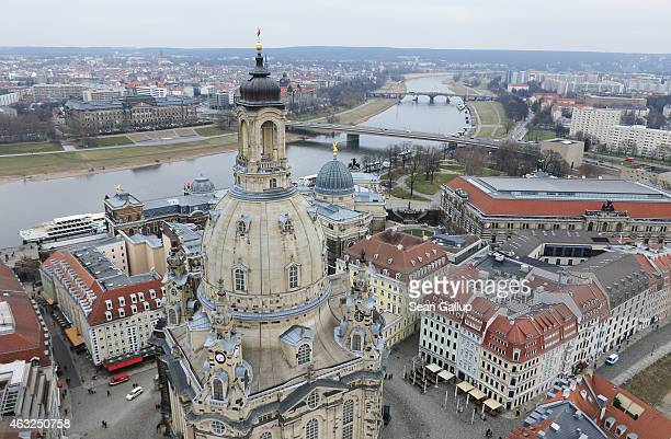 The Frauenkirche cathedral stands in the historic Dresden city center as the Elbe River flows behind seen from the air on February 11 2015 in Dresden...