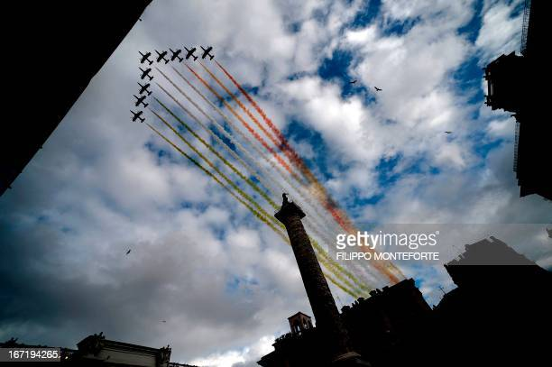 The Frecce Tricolori aerobatic demonstration team of the Italian Aeronautica Militare flies over the Altare della Patria in Rome on April 22 as the...