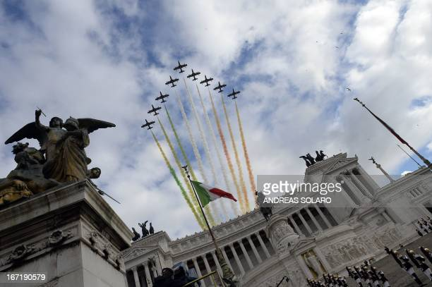 The Frecce Tricolori the aerobatic demonstration team of the Italian Aeronautica Militare fly over the Altare della Patria in Rome on April 22 as the...