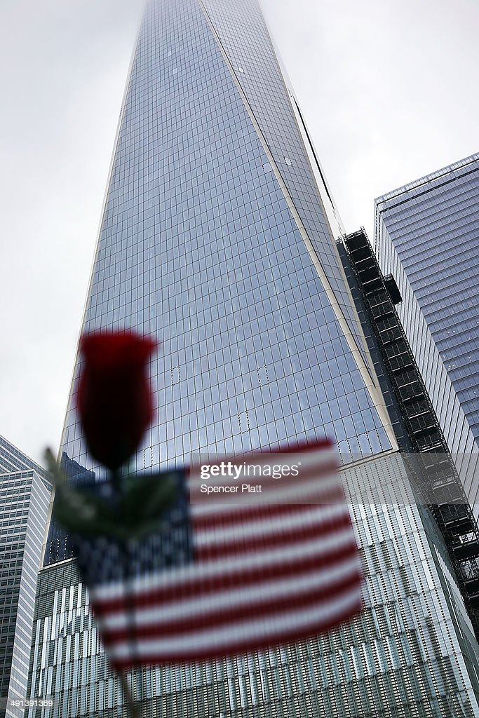 The Freedom Tower is viewed from the North reflecting pool at the Ground Zero memorial site after authorities opened the plaza to the public free of charge on May 16, 2014 in New York City. Prior to today, visitors had to wait in line to enter a barricaded area which includes the newly dedicated National September 11 Memorial Museum. Together with the museum, Ground Zero has become one of the top tourist attractions in the nation with tens of thousands of visitors expected yearly.