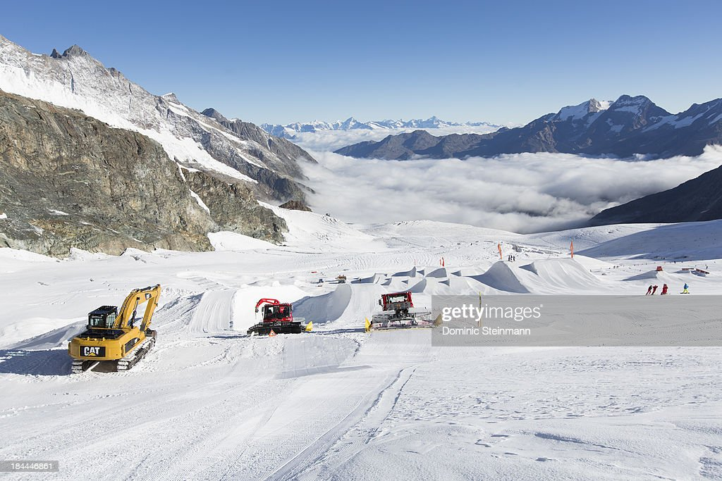 The Freestylepark with a halfpipe and several jumps on the Fee glacier gets prepared by slope machines on September 13, 2013 in Saas-Fee, Switzerland.