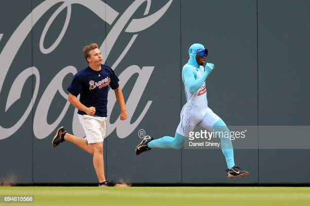 The Freeze races a fan in between innings during a game between the Atlanta Braves and the New York Mets at SunTrust Park on June 10 2017 in Atlanta...