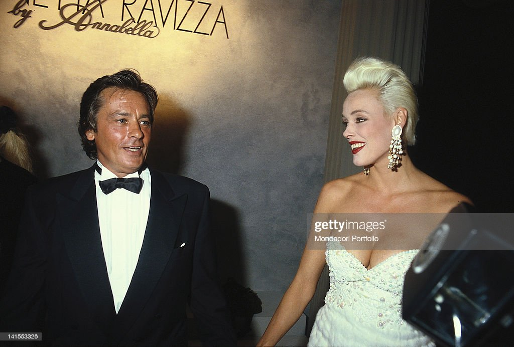 The French actor Alain Delon and the Danish top model Brigitte Nielsen taking part in a gala night. 1990s
