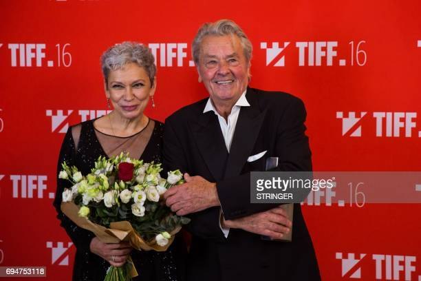 The french actor Alain Delon next to Romanian actress Oana Pellea after he received the 'Lifetime Achievement Award' at Transylvania International...