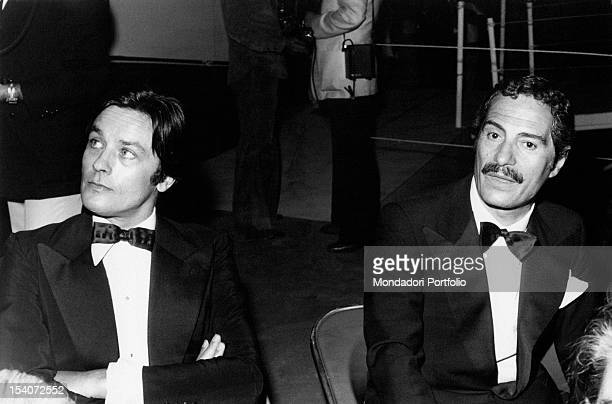 The French actor and director Alain Delon and the Italian actor and director Nino Manfredi attending the prizegiving ceremony of David di Donatello...
