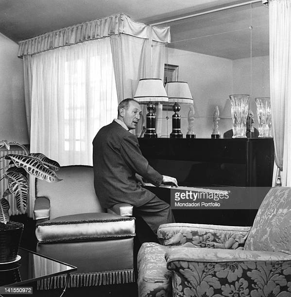 The French actor and singer Bourvil playing the piano 1959