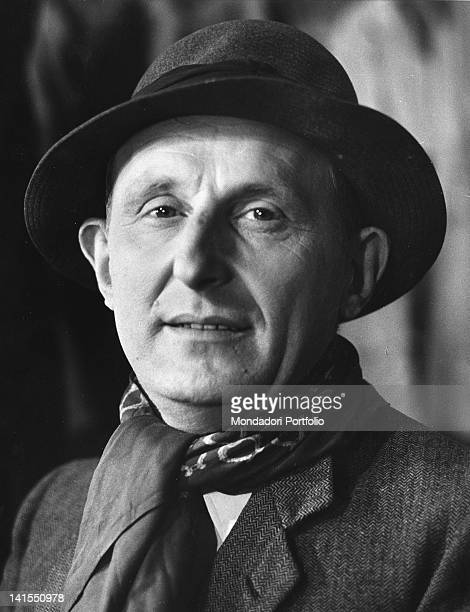 The French actor and singer Bourvil wearing a hat and a scarf 1959