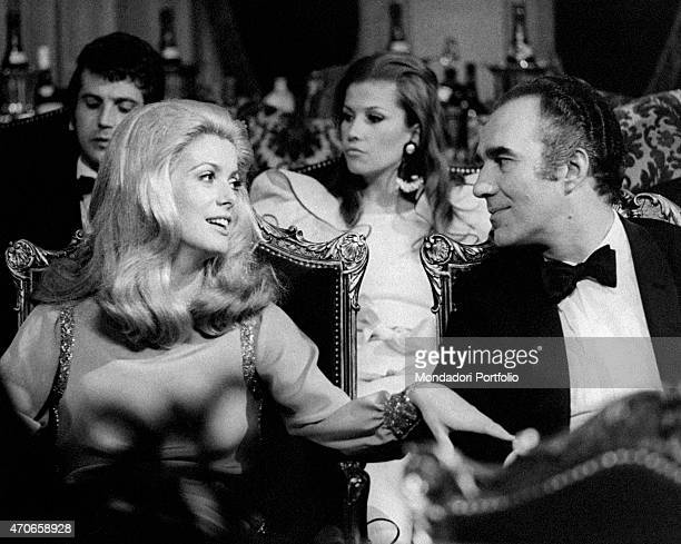 'The French actors Catherine Deneuve pseudonym of Catherine Fabienne Dorlac and Michel Piccoli sitting in the theatre in a scene of the movie La...