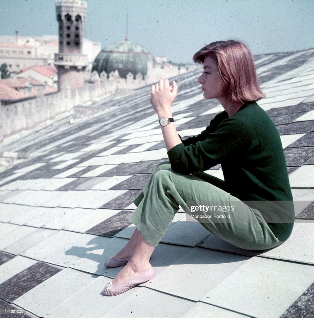 The French actress Anouk Aimee sitting on the Hotel Excelsior roof Venice 1955