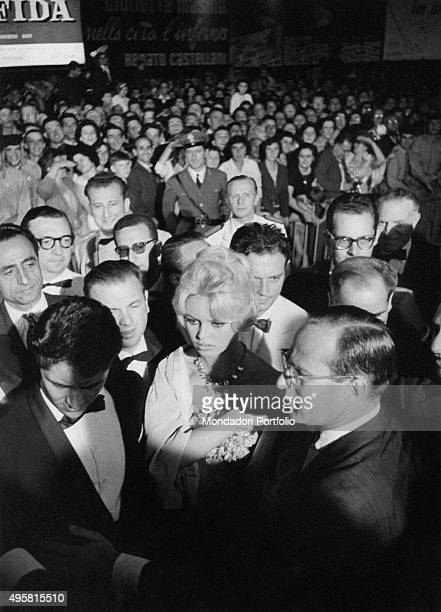 The French actress Brigitte Bardot is surrounded by a crowd of photographers and admirers at the premiere of Claude Autant filmLara's Love Is My...