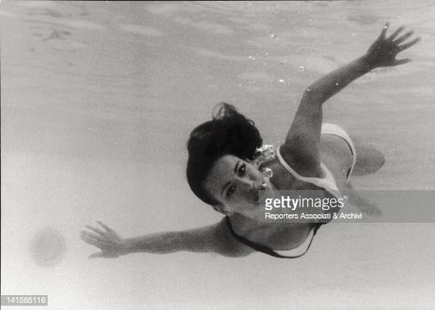 The French actress Claudine Auger is swimming in the water She is playing in the fourth film of the James Bond saga 'Thunderball' She is the Bond...