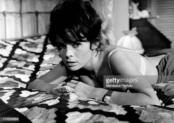The French actress Pascale Petit born AnneMarie Petit lies down on a bed with a serious look in a scene from the movie A Lover for the Summer...