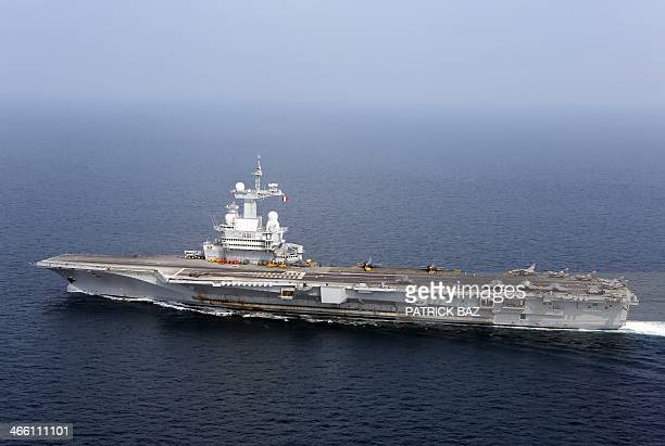 The French aicraft carrier Charles de Gaulle sails in the Gulf of Oman on January 31 2014 The Charles de Gaulle and the USS Harry STrumann aircraft...