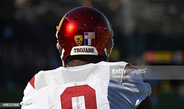 The French and American flags are seen on the helmet of wide receiver JuJu SmithSchuster of the USC Trojans as he warms up before the game against...