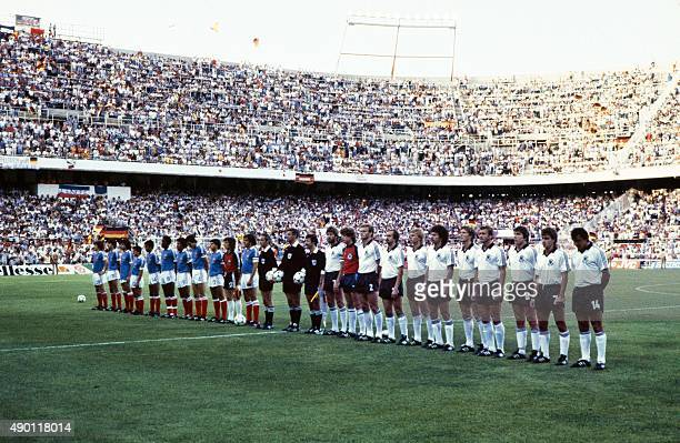 The French and West German teams listen to their national anthems before the 1982 World Cup semifinal football match between West Germany and France...