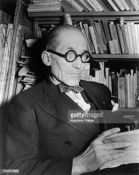 The French architect LE CORBUSIER posing in his Paris apartment on March 21 before leaving for New York to study designing plans for the UN's...