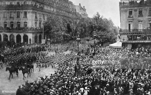 The French army celebrating the Bastille Day la fête nationale on the 14th of July 1916 the French army at the opera square filled with a crowed of...