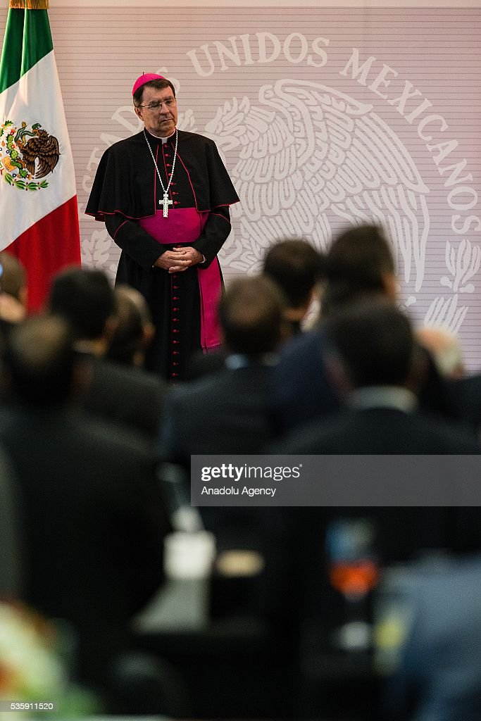 The french bishop Christophe Pierre, Apostolic Nuncio in Mexico, receives the Aguila Azteca Commendation by Claudia Ruiz Massieu, Foreign Affairs Secretary (not seen), due to his service through 9 years in Mexico, in Mexico City, Mexico on May 30, 2016. Pope Francis has already appointed Christophe Pierre his new Apostolic Nuncio in US, the bishop will leave Mexico in the next days.