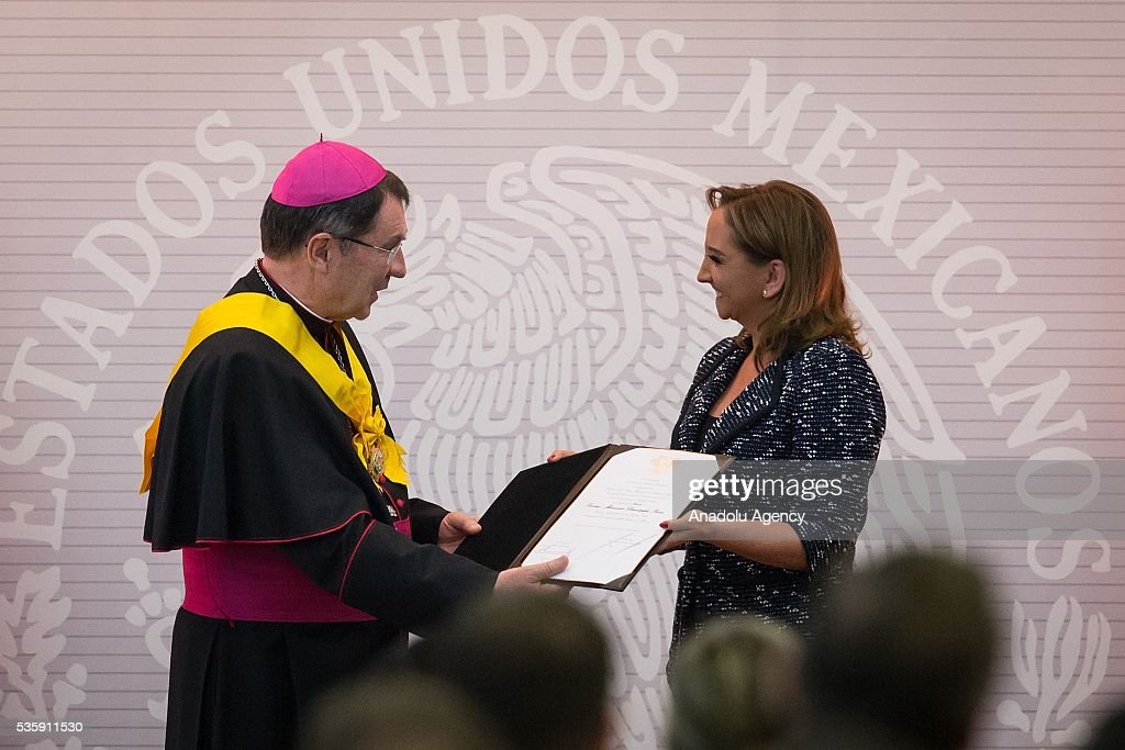 The french bishop Christophe Pierre (L), Apostolic Nuncio in Mexico, receives the Aguila Azteca Commendation by Claudia Ruiz Massieu, Foreign Affairs Secretary (R), due to his service through 9 years in Mexico, in Mexico City, Mexico on May 30, 2016. Pope Francis has already appointed Christophe Pierre his new Apostolic Nuncio in US, the bishop will leave Mexico in the next days.