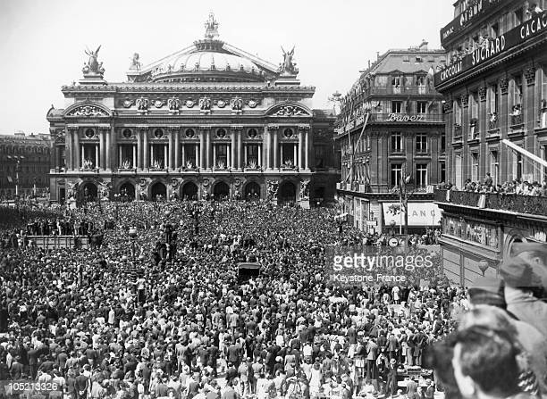 The French Celebrating Germany'S Capitulation And The End Of World War Ii In The West At Place De L'Opera In Paris On May 8 1945