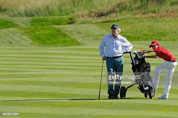 The French dairy food giant Danone Chairman and Chief Executive officer Franck Riboud and his son during the ProAm Rolex before the Alstom Open de...
