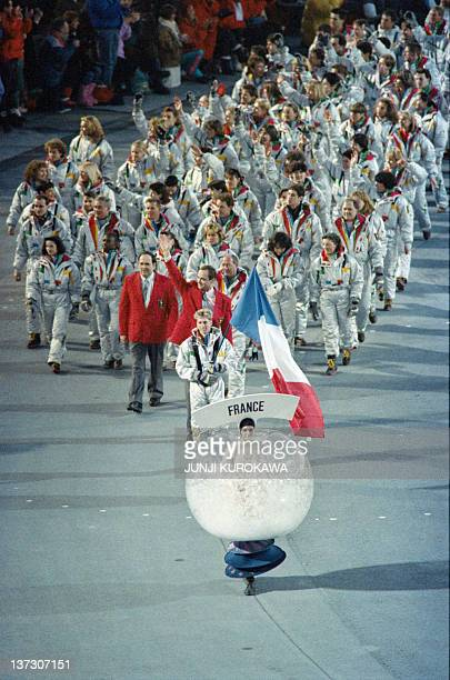 The French delegation marches through Ceremonies Stadium 08 February 1992 in Albertville during the opening ceremony of the XVI Winter Olympics AFP...