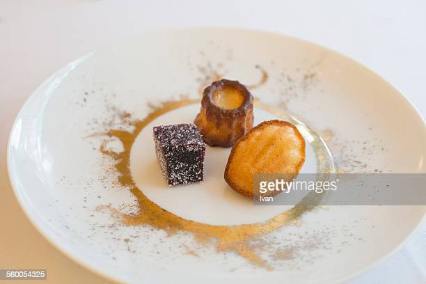 The French dessert: fruit gummy, Madeleine and can